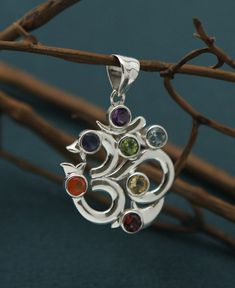 Beautiful sterling silver chakra pendant with Om symbol and 7 colored gemstones that represent the ancient chakra energy centers within the body.