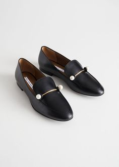 05d0b504 Classic chic leather loafers with a duo pearl gold toned buckle across the  foot.