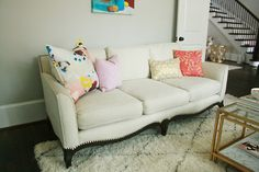 Before + After: White Sofa crypton creme brûlée fabric Crypton Fabric, White Sofas, Colorful Pillows, Love Seat, Couch, Entertaining, Living Room, Furniture, Design