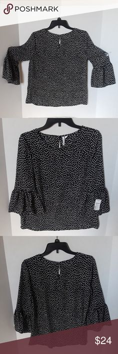Womens Elle Bell Sleeve Polka Dot Blouse Product Features Back Button Closure 3/4 Bell Sleeves Polka dot Pattern  Fabric & Care Polyester Machine wash  Pictures of measurements included Great condition New with Tags Non-smoking home Elle Tops Blouses