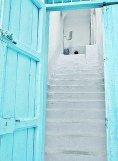 White stairs and aqua door.