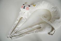 An airplane neck pillow I can get behind!  Lieschen Mueller