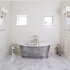 Spectacular master bathroom with white bathroom cabinets paired with Calcutta marble countertops and white framed inset medicine cabinets. Contemporary Bathroom Lighting, Contemporary Bathroom Designs, White Bathroom, Master Bathroom, Grey House Paint, Steel Bath, Moldings And Trim, Moulding, Bathroom Trends