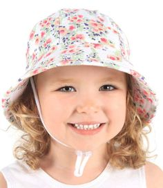 Girls Baby Bucket Hat - Elise Print with Strap - White. Available in 3 sizes from birth. Rated UPF50+ Excellent Protection.  http://www.bedheadhats.com.au/elise-print-baby-bucket-hat-with-strap-white