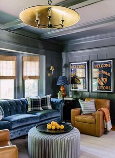 Blue paneled den trims a handsome man cave furnished with a blue velvet tufted chesterfield sofa along with caramel leather accent chair. Living Room Sofa, Living Room Interior, Home Decor Bedroom, Living Room Decor, Living Spaces, Bedroom Boys, Dining Room, Winchester, Round Sofa