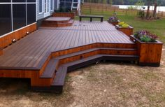 After looking at countless photos of decks, my husband can up with this design. The cedar and composite decking look awesome together!