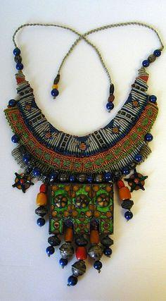 "Necklace | Barbara Natoli Witt.""Tunisian Enameled Silver Pectoral"", 1987.  Nylon thread, silver, lapis, amber, enamelled berber pendant Macrame Necklace, Macrame Jewelry, Diy Necklace, Beaded Bracelets, Gypsy Jewelry, Tribal Jewelry, Jewelry Art, Jewelry Design, Jewellery"