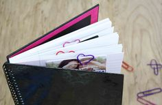 Easy last-minute Valentine gift idea. Quick tutorial on how to tuck gift cards into a journal with homemade, heart-shaped paperclips and love notes all around.
