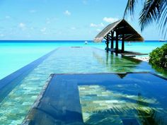 infinity pool with interior hot tub by the beach