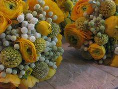 Love this bouquet! Mexican sun ranunculus, billy balls (aka craspedia) and brunia