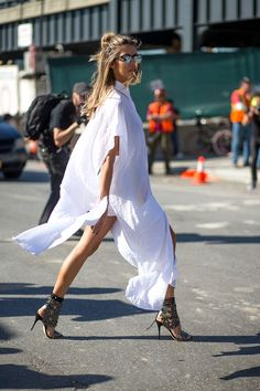 Flowy shirt dresses are amazing. They can be universally flattering. Perfect with a belted waist and statement shoe. NYC Style: Fashion Week from the Street - http://HarpersBAZAAR.com