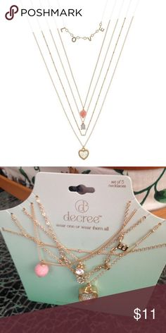 """5-pc. Gold-Tone Delicate Necklace. NWT A pretty multi-layer necklace. Love is the message. The second picture shows the necklace as it will be sent to you. Cute charms and detail. Metal: Gold-tone metal Stones: Clear glass stones Closure: Lobster clasp Dimensions: 22"""" long chain Pendant Size: 17.5x15.5mm Decree Jewelry Necklaces"""