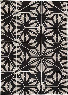 The Catalina collection offers a chic indoor or outdoor accent to patios or high-traffic living spaces. The Haige linear design boasts a dimensional star pattern, recalling iconic mid-century modern motifs. This hooked polypropylene area rug features a bold silver and white on black colorway, livable durability, and an unexpected looped texture.