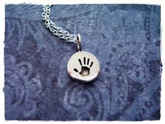 Hey, I found this really awesome Etsy listing at https://www.etsy.com/listing/195823404/tiny-handprint-necklace-sterling-silver