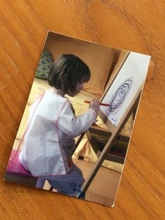 This is a favourite photo of mine ! My daughter, when she was a toddler, being a little artist at her easel ! I welcome the chance to relive this precious time with your little ones if you would like to book a table with your mum friends & children ! Or indeed granny friends !!