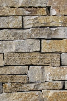 Modern rustic dry stacked stone installation, Fond du Lac Weatheredge Wall Stone, beautiful landscape retaining wall stone design look of stone veneers. Rustic Stone, Modern Rustic, Stone Retaining Wall, Patio Stone, Craftsman Interior, Craftsman Style, Stone Patio Designs, Dry Stack Stone, Rustic Outdoor Decor