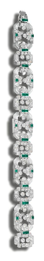 ROCK CRYSTAL, DIAMOND AND EMERALD BRACELET, CIRCA 1925.  The octagonal frosted crystal links embellished with geometrical motifs of calibré-cut emeralds and circular-cut diamonds,  length 192mm.
