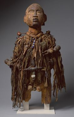 Power Figure (Nkisi), 19th-20th century, wood, paint, nails, cloth, beads, shells, arrows, leather, nuts and twine, Kongo peoples, Democratic Republic of Congo