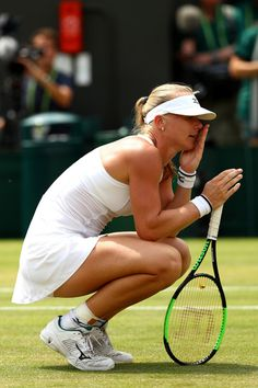 Kiki Bertens of the Netherlands celebrates winning her Ladies' Singles fourth round match against Karolina Pliskova of the Czech Republic on day seven of the Wimbledon Lawn Tennis Championships at All England Lawn Tennis and Croquet Club on July 9, 2018 in London, England.