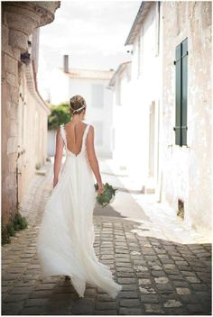 beautiful backless weddingdress pictured on the streets of France via