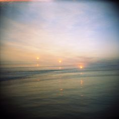 Sunset triple exposure creating the illusion of three suns in the sky.  This image was inspired by a dream I had in the early summer of 2016.  #venice #sunset #holga #tripleexposure #film #dreams #ashleygarmon #ashleygarmonholga #chasingthesuns