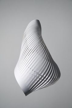 "Richard Sweeney  https://www.pinterest.com/pin/330522060130580020/  ""Commissioned by Queen Rania of Jordan, the sculptural paper gift was produced in an edition of five hundred to mark her Majesty's birthday on the 10th September 2010.  The shape of the piece was created in response to the form of sand dunes. "" (https://www.pinterest.com/pin/330522060127247624/)"