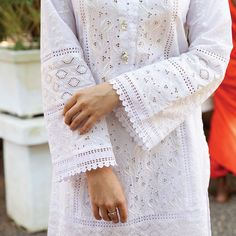 White Chikankari is timeless and so it is forever. AARALIYA, pops with a bright Chiffon dupatta, inspired from the frangipani flower where… Kurti Sleeves Design, Kurta Neck Design, Sleeves Designs For Dresses, Dress Neck Designs, Sleeve Designs, Pakistani Fashion Casual, Pakistani Dresses Casual, Pakistani Dress Design, Salwar Designs