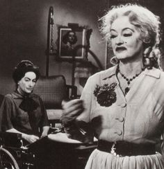 WHAT EVER HAPPENED TO BABY JANE? 1962 Tension mounts on the set with Joan Crawford as Blanche Hudson & Bette Davis as Baby Jane Hudson. From Marie Claire Life Stories article. Film Premiere New York 26 Oct 1962, released in U.S.A 31 Oct 1962 on Halloween. (minkshmink)
