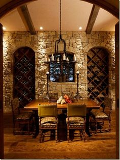 Love the brick wall!! Castle Chic! and wine storage in the wall