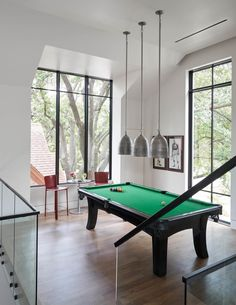 Step inside this dream house in Texas designed for empty nesters #pooltable #billiard #gameroom #mezzanine Board Formed Concrete, Metal Siding, Concrete Fireplace, Mediterranean Style Homes, Open Layout, Texas Homes, Fireplace Surrounds, Step Inside, Pool Houses