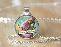 Wine Goddess Altered Art Necklace...    Handcrafted pendant measures 1 inch across (25mm) and has been created using a shiny silver or