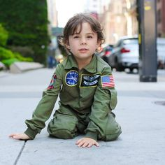 """""""Why are you wearing a pilot's outfit?"""" """"I wear it every day."""" """"Do you want to be a pilot when you grow up?"""" """"No, I want to be a teacher."""" """"Why aren't you wearing a teacher's outfit?"""" """"I don't have one."""" 