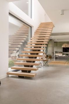 Designed wooden stairs next to glass wall in spacious apartment with decorative accessories from travel , House Staircase, Modern Staircase, Open Stairs, Concrete Interiors, Home Stairs Design, Floating Staircase, Stairs Architecture, Kitchen Room Design, Small House Design