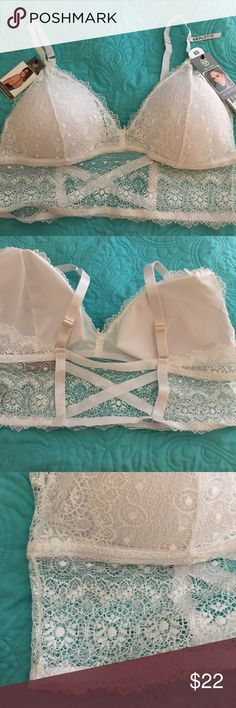 NWT Daisy Fuentes PLUS  long line white lace bra New item! NWT Daisy Fuentes PLUS SIZE long line white lace bra. Cool criss-cross back (see pic) see pic for sizing chart. Padded cups, adjustable straps. Retail $32 Daisy Fuentes Intimates & Sleepwear Bras