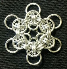 """Celtic Wings Flower. Bright Aluminum, 18g (0.047"""") with 1/4"""" and 5/32"""" IDs."""