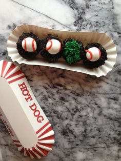 New mini baseball cupcakes at Georgetown Cupcake, served in a  paper hot dog tray.