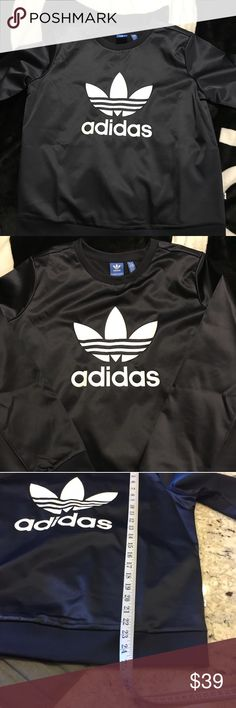 Adidas Trefoil sweatshirt. Deep Navy Blue ( looks more like black).  In excellent condition no stains , rips or smells. Looks Brand New.  I would keep it but it doesn't fit me. adidas Sweaters