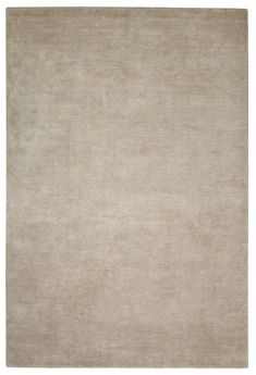 Solid-colour light beige. Hand knotted in natural linen + wool. Made in Nepal. Design Kristiina Lassus.