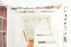 francesco librizzi studio partially suspends delicate staircase within milanese home