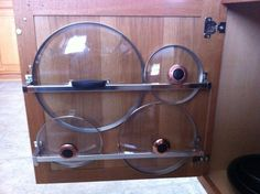 Space Savers - Use towel racks to hang pot lids from cabinet doors.