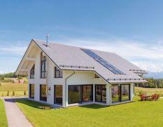 Gut geschnittener Maßanzug - Mit Außenmaßen von 10,37 x 13,92 m plus Wintergartenanbau ist Haus Lausanne von Keitel Haus ein großzügiges Satteldachhaus, das mit viele...