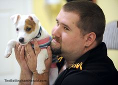 Iraq War veteran Daniel McKenzie of Bellingham plays with his new puppy Pip at Brigadoon Service Dogs on Mission Road east of Bellingham Thursday morning, May 10, 2012. McKenzie is getting the dog to help with his PTSD. McKenzie says the dog will help him de-stress and unwind. View the comments to read more.