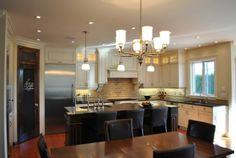 Medium floor / light cabinets / dark counter tops