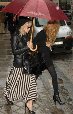 MKA OLSEN MARY KATE ASHLEY PARIS BLACK AND WHITE STRIPE SKIRT CHRISTIAN LOUBOUTIN HEELS LEATHER JACKET UMBRELLA BLACK DRESS TIGHTS ANKLE BOOTS BEANIE HAT RINGS PEARL NECKLACE RED HEAD AVIATOR SUNGLASSES VINTAGE CROC FENDI BAG