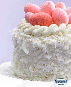 If there's any way to get someone's attention away from chocolate on Easter, this white cake will make dreams come true. It's filled with raspberry jam, frosted with a simple cream cheese frosting and garnished with shaved coconut. Top it with pretty sugar eggs and watch the crowd come hopping.