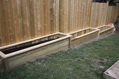 flower beds along fence | Raised Garden Beds along sloping fence