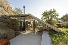Architecture firm Lund Hagem have designed a small cabin, located in Sandefjord, Norway. The site was originally home to two small sheds, which have since been replaced by the cabin. Nestled between large rocks and dense vegetation, the new building has a roof that fits around the shapes of the rock…