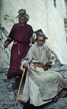 Two pilgrims pick their way down from Hemis Gompa.   Photo by T. J. Abercrombie, 1978.