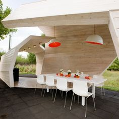 i want this gazebo - the orange accents are a nice contrast with the natural wood & flooring