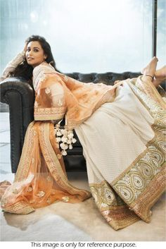 Get a Beautiful look By Bollywood Style Rani Mukerji Net Off White and Peach Colour Lehenga  #bollywood #RaniMukherji